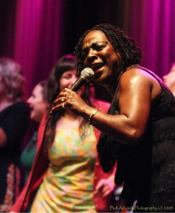 Sharon Jones dancing with some ladies she invited up on stage